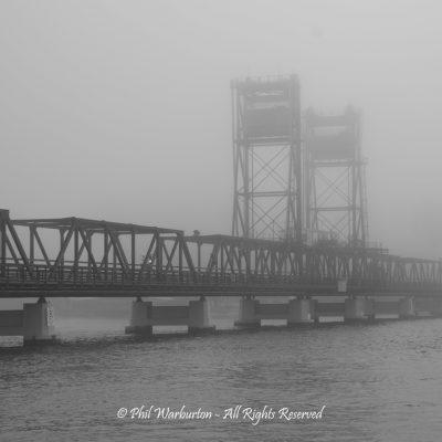 Bridge in the mist by Phil Warburton
